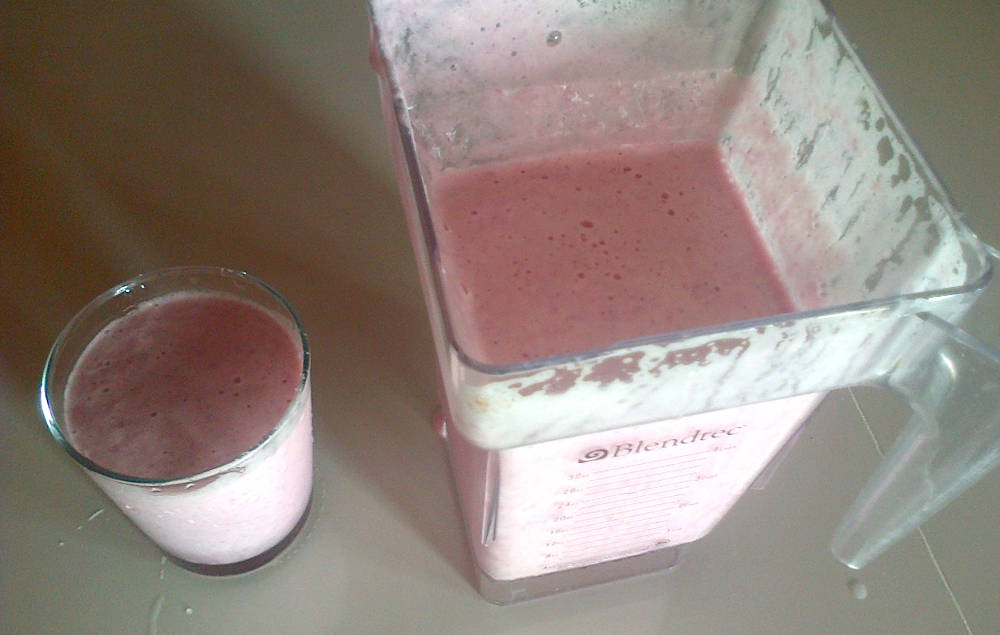 Pink Pineapple Ginger Smoothie glass and blender