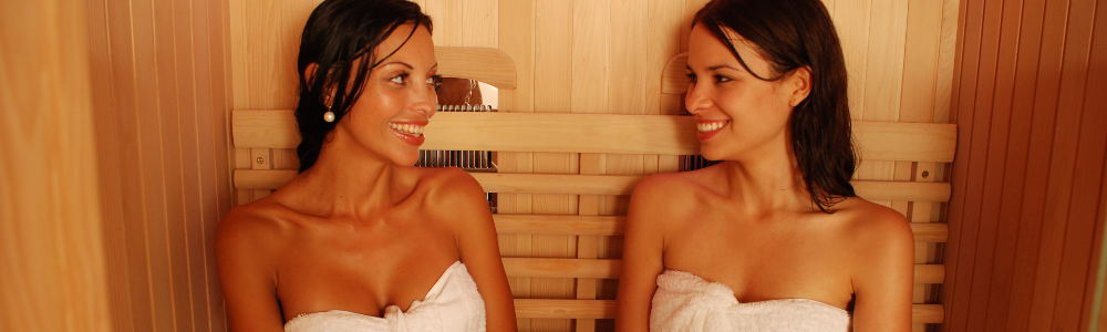 Two ladies relaxing in a sauna