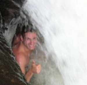 Michael Ducharme bathing in a waterfall in Panama